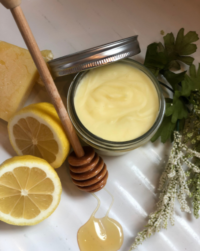 salve sitting on counter with lemons and honey