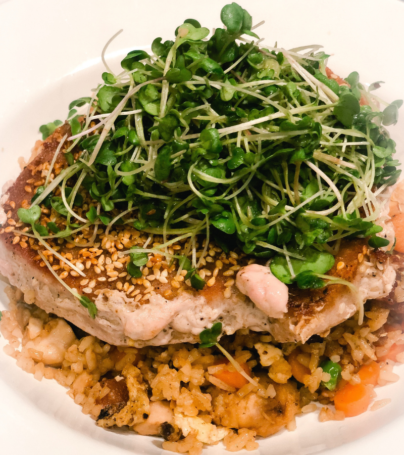 Home grown indoors greens tossed in sesame dressing and piled high on top of seared tuna.
