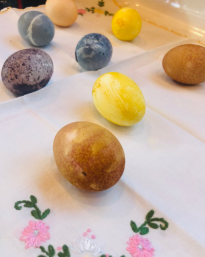 All natural, food based non toxic Easter eggs on linen napkin with flower embroidery