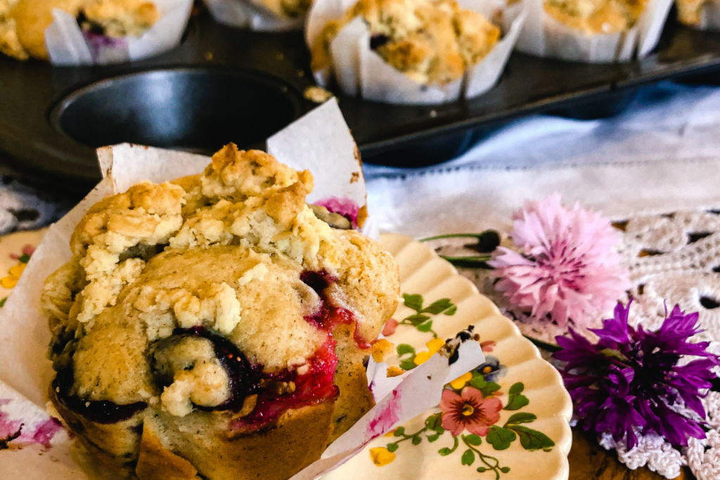 I can't think of a single person who doesn't enjoy a good muffin. . . muffin with coffee in the morning is just about perfect for me. These Blueberry Streusel Muffins are absolutely out of this world moist and delicious. Let me share the basic sweet muffin recipe with you and you can add whatever fruit combo YOU enjoy!