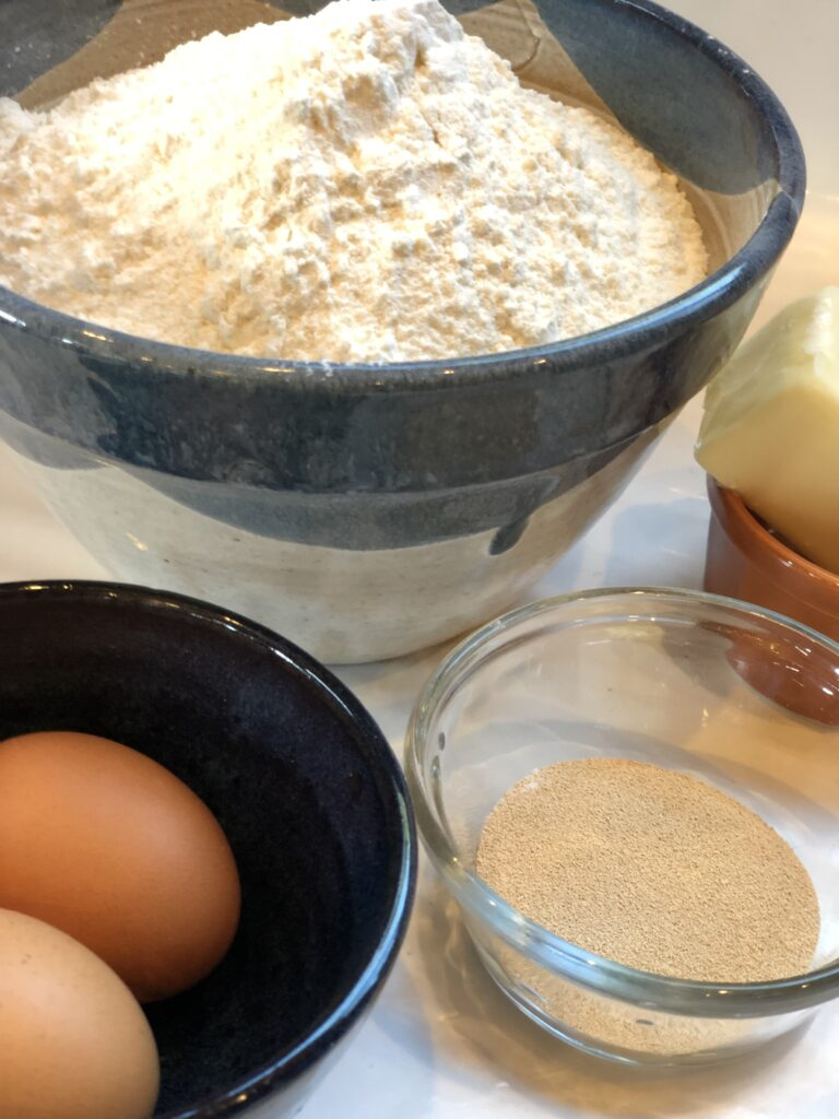 Flour, eggs, yeast and butter all waiting patiently to make traditional homemade white bread.