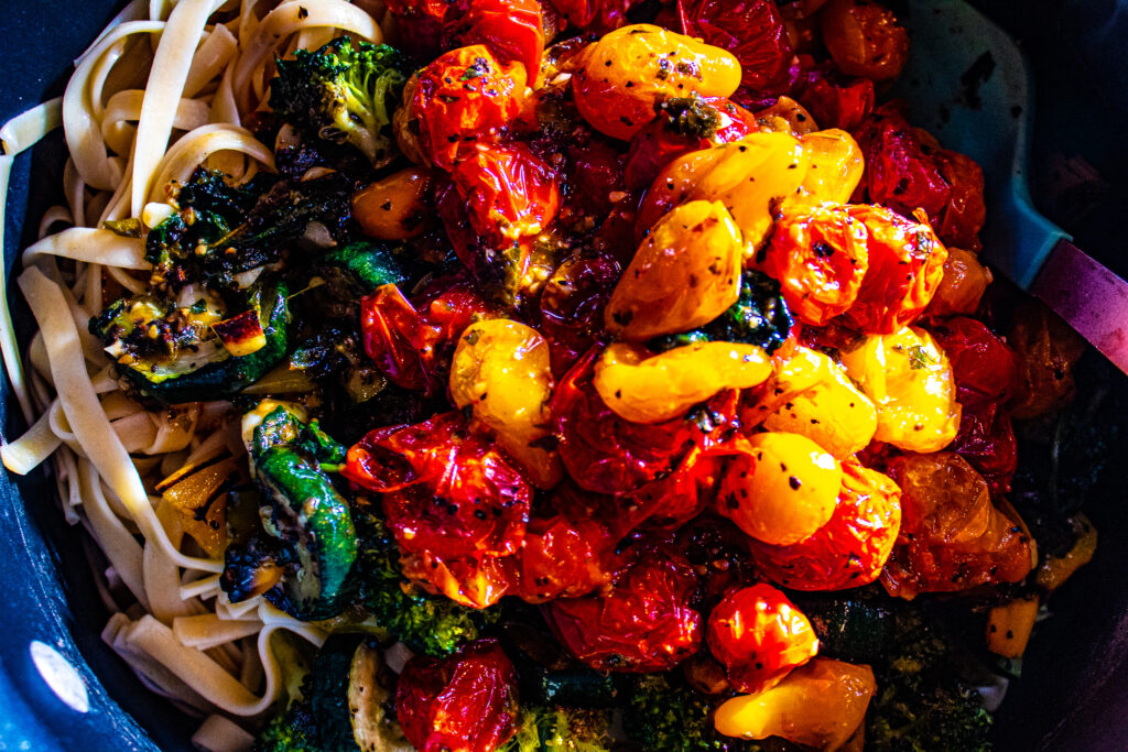 This recipe is nearly a one dish, sheet-pan supper. Just boil noodles while all the veggies roast together. The tomatoes burst and mix with butter to form a rich delicious sauce to spoon over the pasta. Top with grated parmesan. Roasted Garden Veggie Pasta is absolutely full of fresh flavor and couldn't be easier to make.